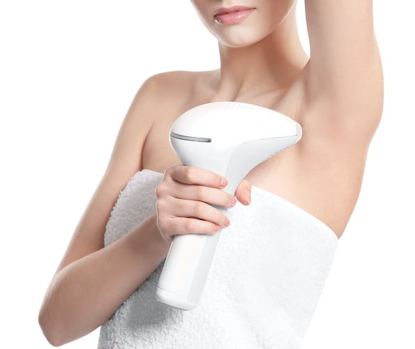 woman with laser epilator
